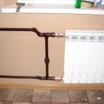 Замена радиаторов отопления, перенос на балкон